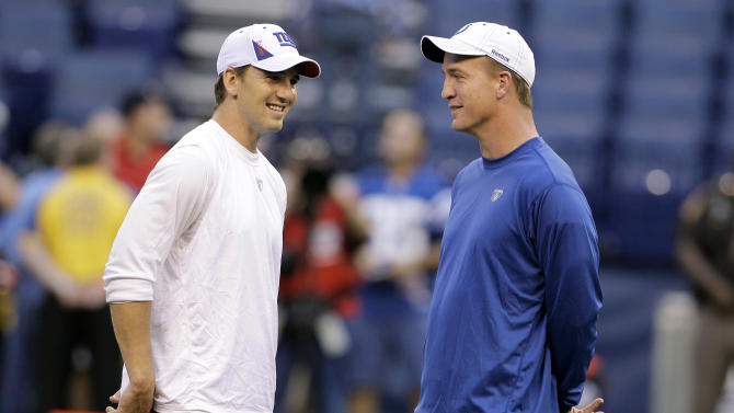 "FILE - This Sept. 19, 2010 file photo shows New York Giants quarterback Eli Manning, left, talking with his brother, Indianapolis Colts quarterback Peyton Manning, before an NFL football game in Indianapolis. Eli says he didn't want to host ""Saturday Night Live"" after his first Super Bowl victory because it came so soon after big brother Peyton's appearance a year earlier. He sent word back to the show's executives that perhaps he'd host if he won another championship. Sure enough, the Giants quarterback said yes after his second title and will star in the comedy sketches Saturday. (AP Photo/Darron Cummings, File)"