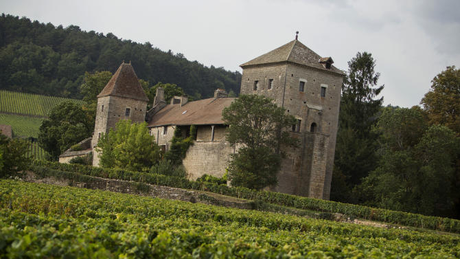 This Sept. 10, 2012 photo shows the Gevrey-Chambertin castle amid vinyards in Burgundy, eastern France. Gevrey-Chambertin is the kind of French village where the waiter chastises diners who don't order a glass of locally made wine, even at a midweek lunch. So when Louis Ng Chi Sing, a Macau casino magnate, purchased the thousand-year-old Chateau de Gevrey-Chambertin and some surrounding vineyards in May for 8 million euros ($10.5 million) it set off a firestorm. (AP Photo/Laurent Cipriani)