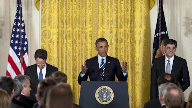 President Barack Obama, accompanied by outgoing Treasury Secretary Timothy Geithner, left, and current White House Chief of Staff Jack Lew, right, gestures as he arrives in the East Room of the White House in Washington, Thursday, Jan. 10, 2013, to announce he will nominate Lew to succeed Geithner.  (AP Photo/Carolyn Kaster)