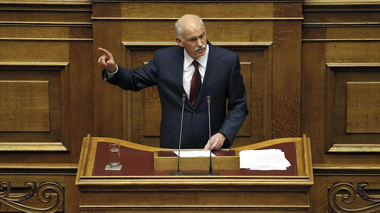 Greek Prime Minister George Papandreou speaks during a confidence vote meeting at the parliament in Athens, on Friday, Nov. 4, 2011. Greece's ruling Socialists were in open revolt against their own prime minister ahead of a confidence vote Friday, in a political free-for-all over a new European plan to keep the deeply indebted country afloat.(AP Photo/Petros Giannakouris)