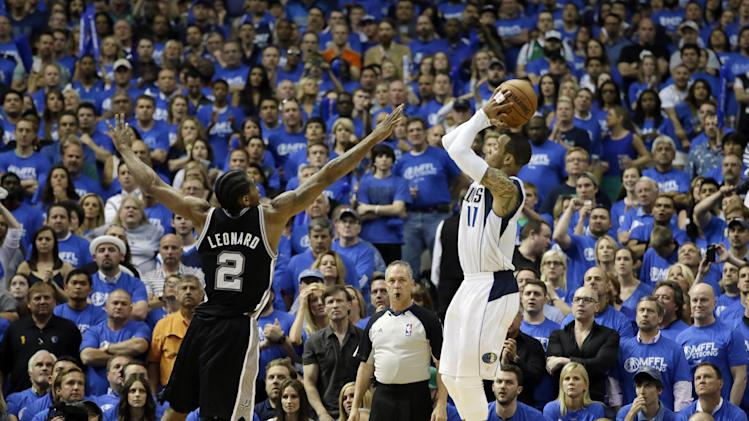Dallas Mavericks' Monta Ellis, right, goes up to shoot as San Antonio Spurs' Kawhi Leonard (2) defends in the second half of Game 6 of an NBA basketball first-round playoff series on Friday, May 2, 2014, in Dallas. The Mavericks won 113-111. (AP Photo/Tony Gutierrez)