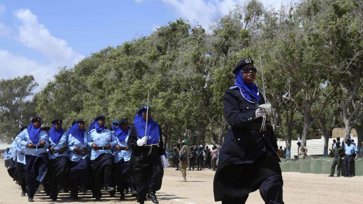 Somali policewomen march in a passing out parade during celebrations to mark the Somali Police Force's 70th founding anniversary in Mogadishu