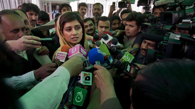 Pakistan's Foreign Minister Hina Rabbani Khar talks to media as she leaves after attending parliament's joint session in Islamabad, Pakistan on Tuesday, March 20, 2012. A parliamentary commission demanded an end to American drone attacks inside Pakistan and an apology for deadly U.S. airstrikes in November, as part of proposed new terms in the country's troubled relations with the United States. (AP Photo/Anjum Naveed)
