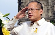 Philippine President Benigno Aquino (pictured on June 12) has ordered home its two ships engaged in a maritime stand-off with China over a disputed shoal, citing bad weather, according to the government