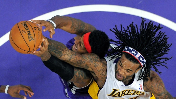 Sacramento Kings forward James Johnson, left, and Los Angeles Lakers center Jordan Hill battle for a rebound during the first half of their NBA basketball game, Sunday, Nov. 11, 2012, in Los Angeles. The Lakers won 103-90.  (AP Photo/Mark J. Terrill)