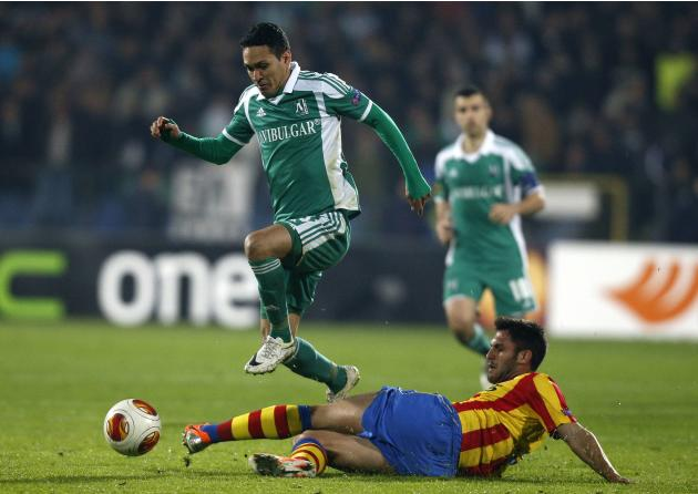 Marcelinho of Ludogorets is challenged by Ruiz of Valencia during their Europa League match in Sofia