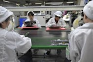 Chinese workers in the Foxconn factory in Shenzhen, in southern China's Guangdong province. China Labor Watch reported that other Apple suppliers had treated their staff worse than Foxconn, which has received the most attention