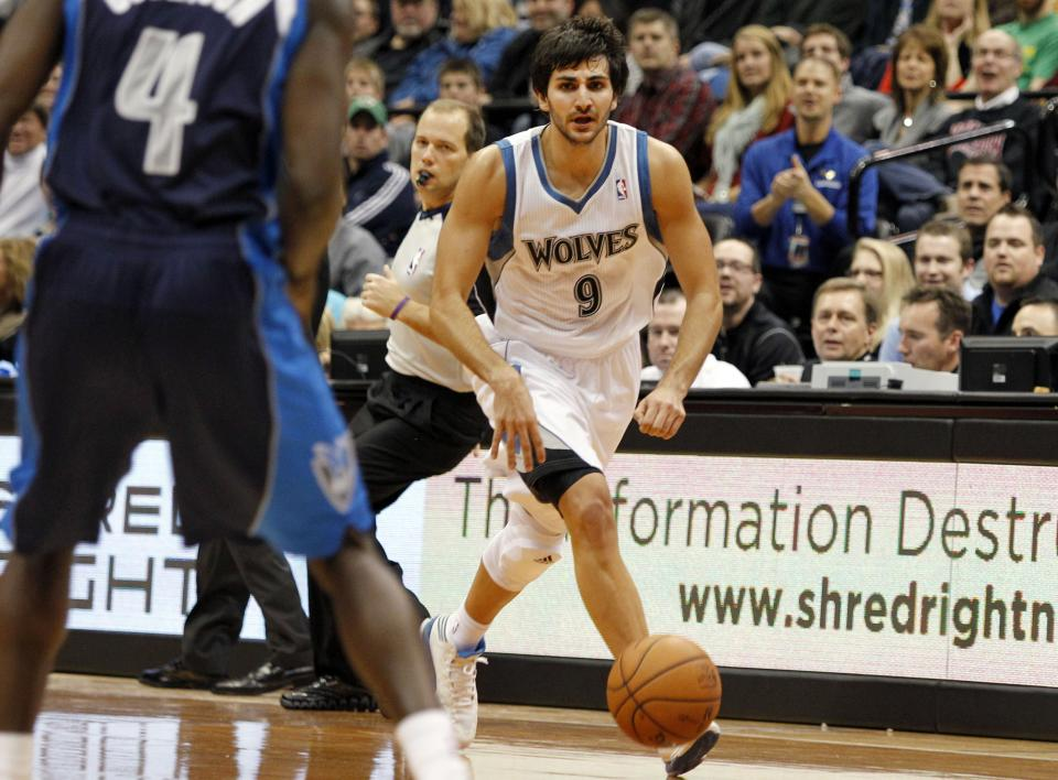 Minnesota Timberwolves point guard Ricky Rubio (9), of Spain, brings the ball upcourt on a steal against the Dallas Mavericks during the first half on an NBA basketball game on Saturday, Dec. 15, 2012, in Minneapolis. Rubio was making his season debut after recovering from surgery on his left knee. (AP Photo/Genevieve Ross)