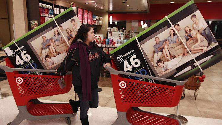 Target customer Nancy, last name not given, waits with televisions purchased at aTarget Store in Colma, Calif., Friday, Nov. 25, 2011. The American holiday shopping season began in earnest Friday as stores opened their doors at midnight _ a few hours earlier than they normally do on the most anticipated shopping day of the year. (AP Photo/Jeff Chiu)