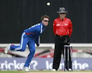 England spinner Graeme Swann (left) is nursing a sore elbow
