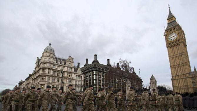 """Members of Britain's armed forces march from Wellington Barracks to The Houses of Parliament during the final """"March Into Parliament"""" for Operation Herrick in London"""