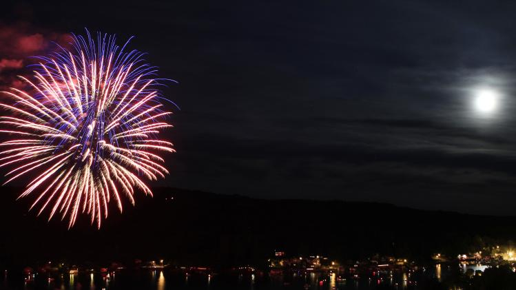 Fourth of July fireworks are set off on Lake Winnipesaukee, Tuesday, July 3, 2012 in Alton Bay, N.H. (AP Photo/Jim Cole)