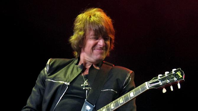 """FILE - This May 20, 2012 file photo shows Bon Jovi guitarist Richie Sambora performing at the Bamboozle Festival in Asbury Park N.J. Sambora's solo release """"Aftermath of Lowdown"""" covers a lot of personal ground for the rocker including his much-publicized divorce from Heather Locklear, his ongoing battle with alcohol and substance abuse, and the virtues of being a parent.  (AP Photo/Wayne Parry, file)"""