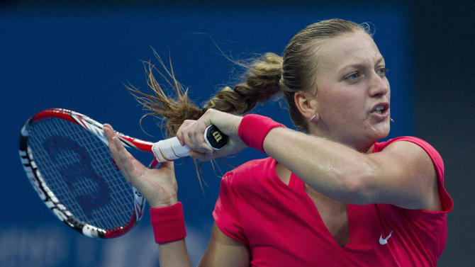 Petra Kvitova of the Czech Republic returns a shot to Li Na of China during the China Open tennis tournament at National Tennis Stadium in Beijing, China Friday, Oct. 4, 2013. (AP Photo/Andy Wong