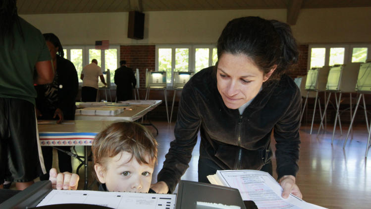 Micah Olmstead, 3, helps his mother, Jill Olmstead, cast her ballot while voting in the California primary  in Sacramento, Calif., Tuesday,  June 5, 2012. Voter turnout could set a record low for a presidential primary in the state with just 35 percent of registered voters expected to cast ballots according the Field Poll .(AP Photo/Rich Pedroncelli)