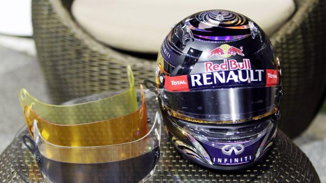 The helmet and visors of Red Bull Formula One driver Vettel of Germany is shown to the media at the paddock area ahead of the Singapore F1 Grand Prix in Singapore