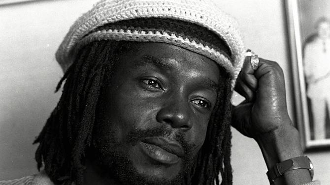"""FILE - In this Feb. 1979 file photo, Jamaican reggae singer Peter Tosh is shown in the office of a record company in Hollywood, California. For his musical contributions, Tosh's daughter, Niambe, received on Monday, Oct. 15, 2012, the posthumous """"Order of Merit"""" for her father, during the island's annual national heroes ceremony. Tosh, a founding member of the reggae band The Wailers along Bob Marley and Bunny Wailer, was killed in 1987 at age 42 by robbers who broke into his Jamaican home. (AP Photo/File)"""