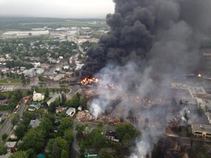 This aerial photo shows a fire in the town of Lac-Megantic…