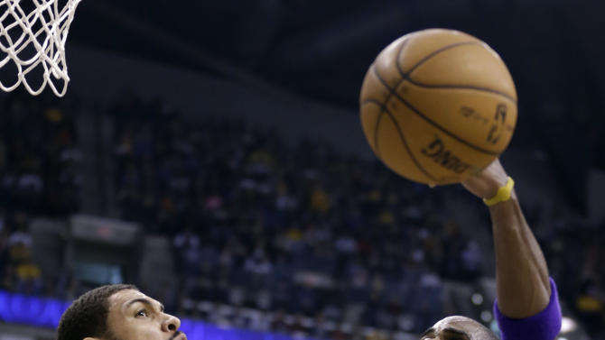 Indiana Pacers forward Jeff Pendergraph, left, blocks the shot of Los Angeles Lakers forward Antawn Jamison during the first half of an NBA basketball game in Indianapolis, Friday, March 15, 2013. (AP Photo/Michael Conroy)