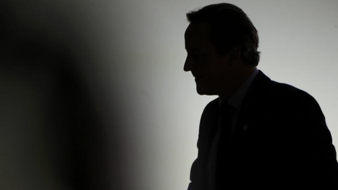 Britain's Prime Minister Cameron is seen silhouetted before delivering a speech  during the opening session of the World Climate Change Conference 2015 (COP21) at Le Bourget