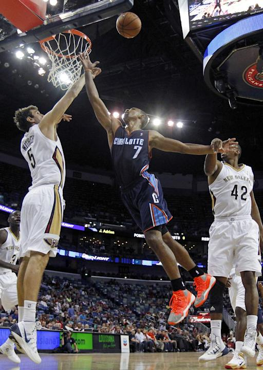 Charlotte Bobcats point guard Ramon Sessions (7) goes to the basket between New Orleans Pelicans center Jeff Withey (5) and forward Lance Thomas (42) in the second half of an NBA basketball game in Ne