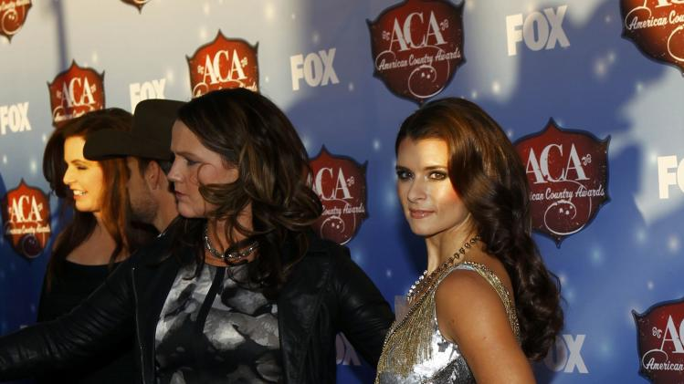 Race car driver Danica Patrick poses during the 4th annual American Country Awards in Las Vegas