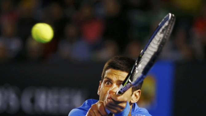 Djokovic of Serbia reaches for a shot to Muller of Luxembourg during their men's singles match at the Australian Open 2015 tennis tournament in Melbourne