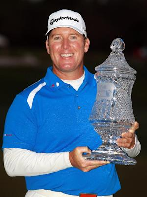 D.A. Points poses with the trophy after winning the Houston Open golf tournament, Sunday, March 31, 2013, in Humble, Texas. Points came back from a long rain delay and made four pars, the last of which gave him a one-shot victory and an invitation to the Masters. (AP Photo/Patric Schneider)