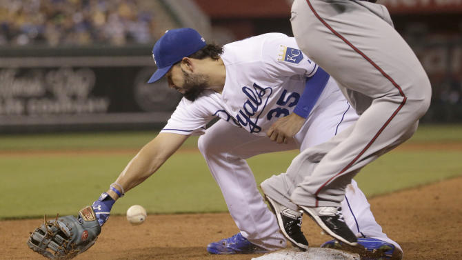 Kansas City Royals first baseman Eric Hosmer can't hold the ball as Minnesota Twins' Miguel Sano crosses first for a single during the ninth inning of a baseball game Thursday, July 2, 2015, in Kansas City, Mo. (AP Photo/Charlie Riedel)
