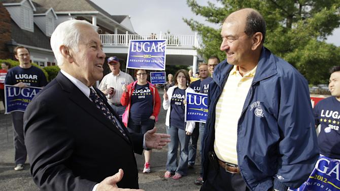 Sen. Richard Lugar talks with Joe Purichia before voting on Tuesday, May 8, 2012, in Greenwood, Ind. Lugar is being challenged by two-term state Treasurer Richard Mourdock. (AP Photo/Darron Cummings)