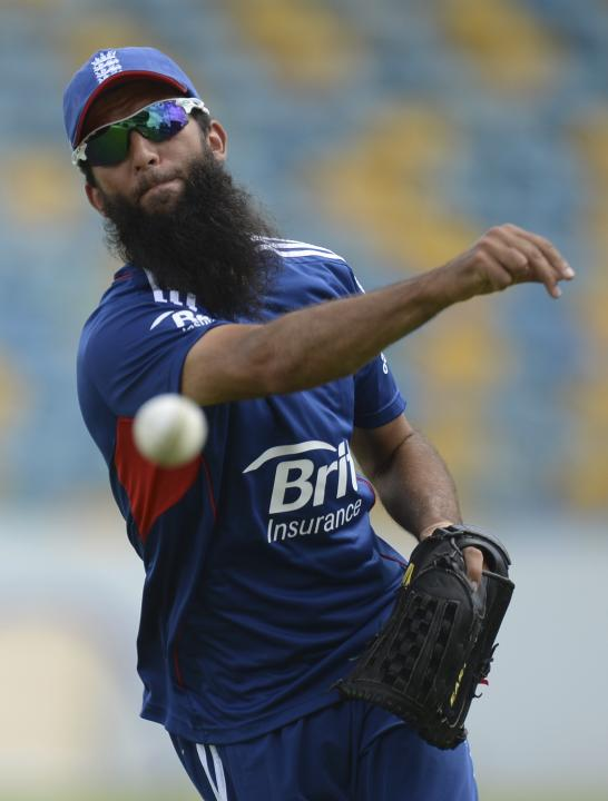 England's Ali throws a ball during a training session before Sunday's first T20 international against the West Indies' at Kensington Oval in Bridgetown, Barbados