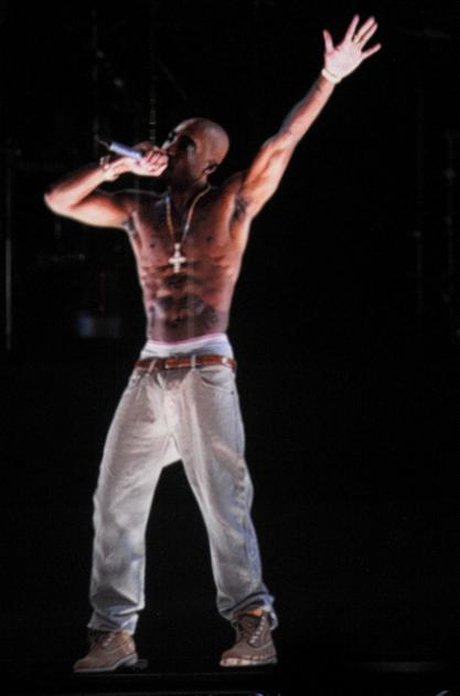 A holographic image of Tupac Shakur is seen performing during day 3 of the 2012 Coachella Valley Music & Arts Festival at the Empire Polo Field in Indio, Calif. on April 15, 2012 -- Getty Images