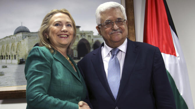 U.S. Secretary of State Hillary Rodham Clinton, left, shakes hands with Palestinian President Mahmoud Abbas during a meeting in the West Bank city of Ramallah, Wednesday, Nov. 21, 2012. Clinton will try on Wednesday to wring an elusive truce deal from Israel and Gaza's militant Hamas rulers after earlier efforts to end more than a week of fighting broke down amid a furious spasm of violence.(AP Photo/Alaa Badarneh, Pool)