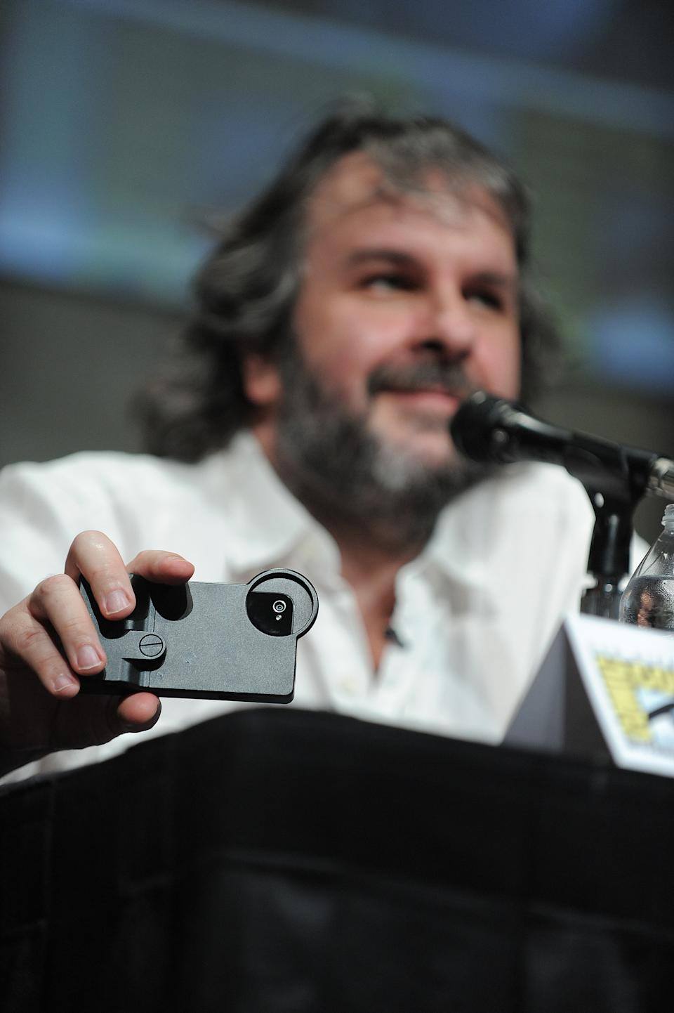 "Peter Jackson films the audience at the ""The Hobbit: An Unexpected Journey"" panel 2012 Comic Con on Saturday, July 14, 2012 in San Diego, Calif. (Photo by Jordan Strauss/Invision/AP)"