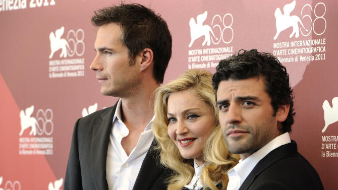 British actor James D'Arcy, US singer and director Madonna and actor Oscar Isaac pose at the photo call for the film W.E. during the 68th edition of the Venice Film Festival in Venice, Italy, Thursday, Sept. 1, 2011. (AP Photo/Jonathan Short)