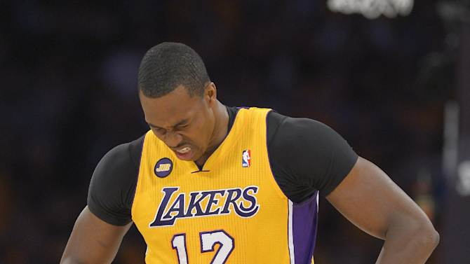 Los Angeles Lakers center Dwight Howard reacts after being fouled against the San Antonio Spurs during the first half in Game 3 of a first-round NBA basketball playoff series, Friday, April 26, 2013, in Los Angeles. (AP Photo/Mark J. Terrill)