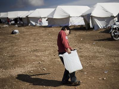 Syrians flee their homes for tented camps