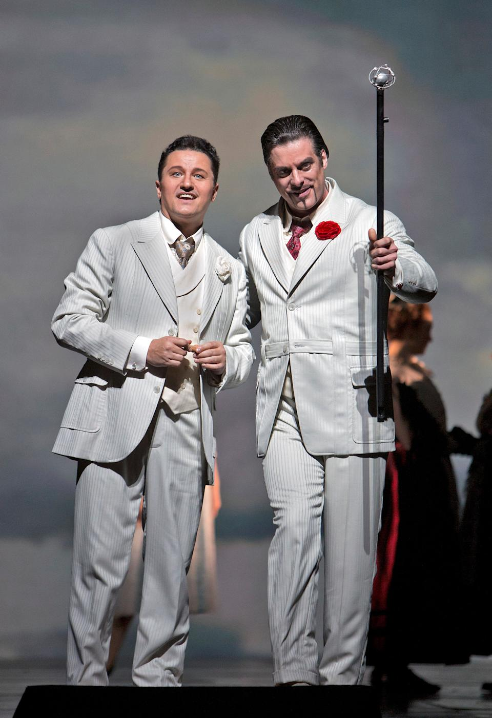 "In this March 18, 2013 photo provided by the Metropolitan Opera, Piotr Beczala is Faust and John Relyea is Méphistophélès during a dress rehearsal of ""Faust"" at the Metropolitan Opera in New York. (AP Photo/Metropolitan Opera, Cory Weaver)"