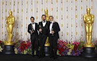 "The producers of ""Argo, winner for best picture, Grant Heslov, Ben Afleck (C) and George Clooney (R), pose with their awards backstage at the 85th Academy Awards in Hollywood, California, February 24, 2013. REUTERS/Mike Blake"
