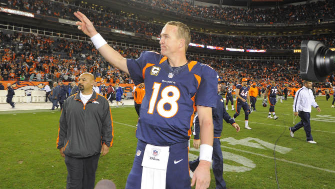 Denver Broncos quarterback Peyton Manning (18) waves to fans after beating the San Diego Chargers 30-23 in an NFL football game, Sunday, Nov. 18, 2012, in Denver. (AP Photo/Jack Dempsey)