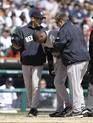 New York Yankees' Eduardo Nunez grimaces while helped to the dugout by manager Joe Girardi, left, and assistant trainer Mark Littlefield, after being hit by a pitch from Detroit Tigers starting pitcher Doug Fister during the fourth inning of a baseball game in Detroit, Friday, April 5, 2013. (AP Photo/Carlos Osorio)