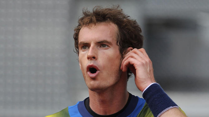 Andy Murray from Great Britain gestures during the match against Florian Mayer from Germany at the Madrid Open tennis tournament, in Madrid, Tuesday, May 7, 2013. (AP Photo/Andres Kudacki)