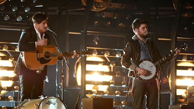 Marcus Mumford, left, and Winston Marshall, of musical group Mumford & Sons, perform at the 55th annual Grammy Awards on Sunday, Feb. 10, 2013, in Los Angeles. (Photo by John Shearer/Invision/AP)