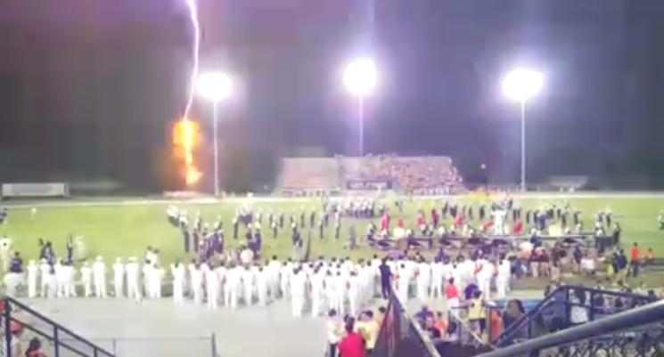 Lightning strikes directly behind the Boone football team during halftime of a game — Orlando Sentinel screenshot