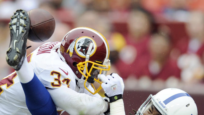Washington Redskins safety Tanard Jackson breaks up a pass intended for Indianapolis Colts wide receiver Kris Adams to end the first half of an NFL preseason football game Saturday, Aug. 25, 2012, in Landover, Md. (AP Photo/Nick Wass)