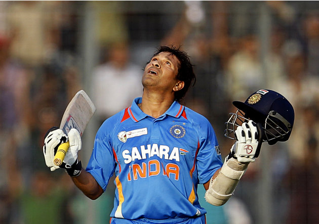 Indian cricketer Sachin Tendulkar celebrates scoring his 100th century during the Asia Cup cricket match against Bangladesh in Dhaka, Bangladesh, Friday, March 16, 2012. Tendulkar, who had been stuck