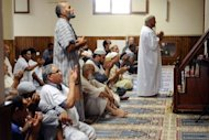 People pray in the Montauban's mosque, southwestern France. French Muslim and Jewish groups were united in outrage Wednesday after two pig heads were dumped at a mosque in a town where an Islamist gunman killed two paratroopers in March