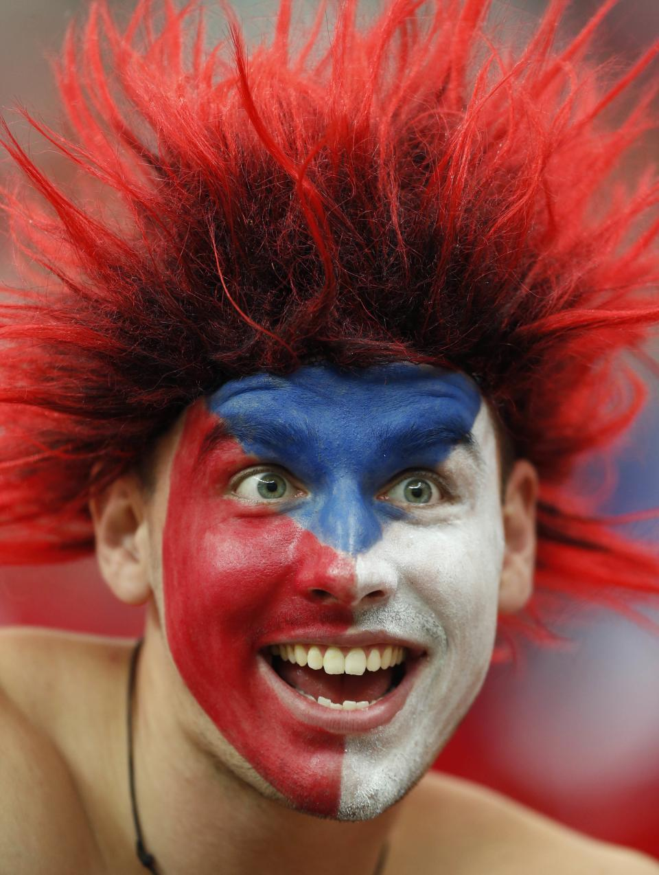 A Czech fan cheers before the Euro 2012 soccer championship quarterfinal match between Czech Republic and Portugal in Warsaw, Poland, Thursday, June 21, 2012. (AP Photo/Jon Super)