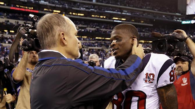 Indianapolis Colts head coach Chuck Pagano, left, talks to Houston Texans' Andre Johnson following an NFL football game, Sunday, Dec. 30, 2012, in Indianapolis. The Colts won the game 28-16. (AP Photo/Michael Conroy)