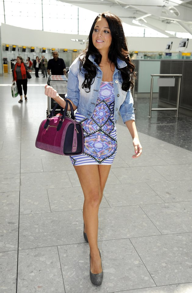 Tulisa shows off long legs
